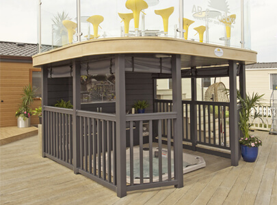 AB Sundecks Handrails and Platform with Picket Panel and Steel Glass surrounding Hot Tub with an array of chairs and tables above